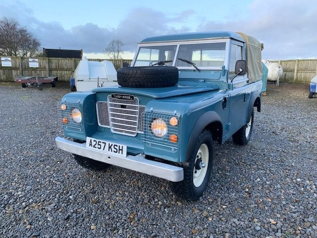 A vintage Series 3 Land Rover with truck-cab and canvas